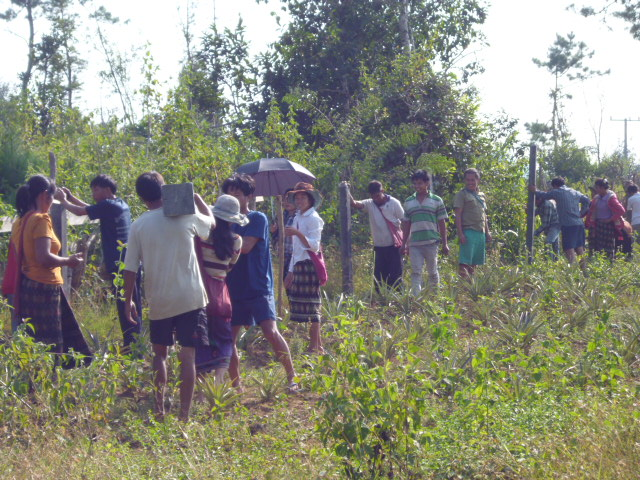 Ban Xai villagers erecting fence