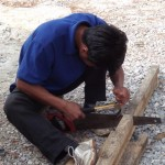 Our carpenter, Mr No, setting a saw with a claw hammer